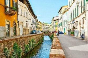 Colourful apartments either side of the Via del Fosso canal in Tuscany's northern city of Lucca